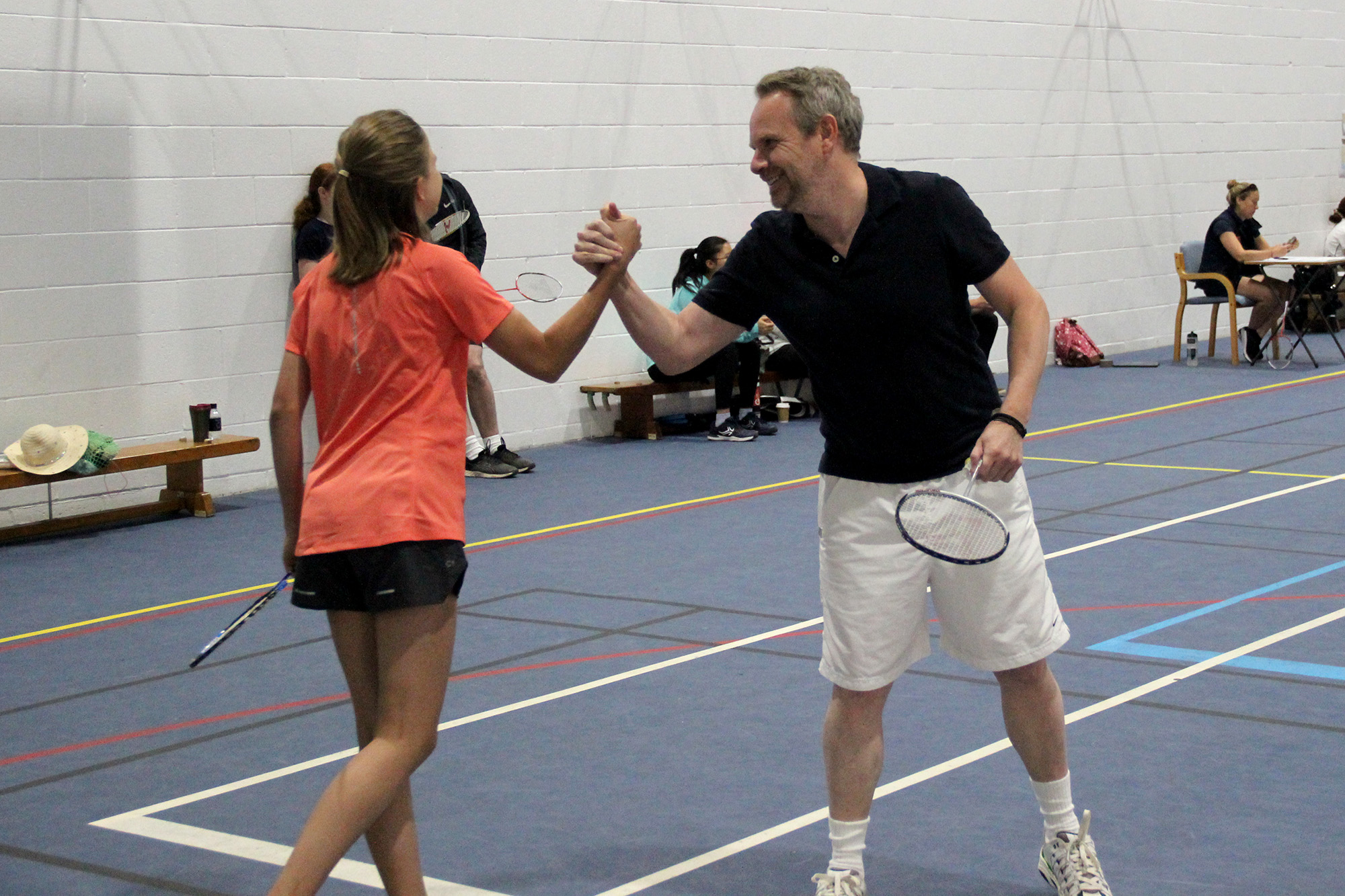 Daughter and parent playing badminton
