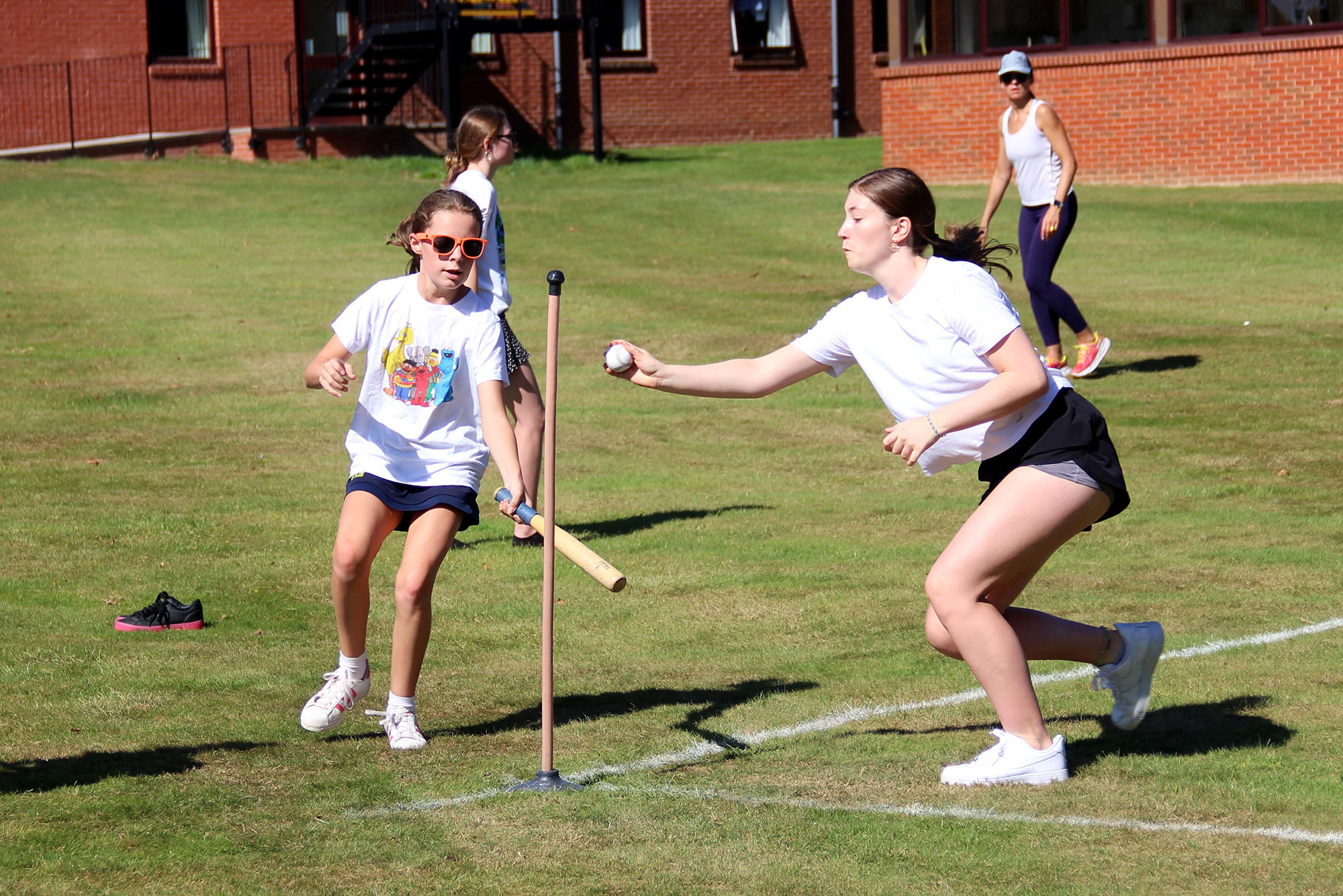 girls play rounders