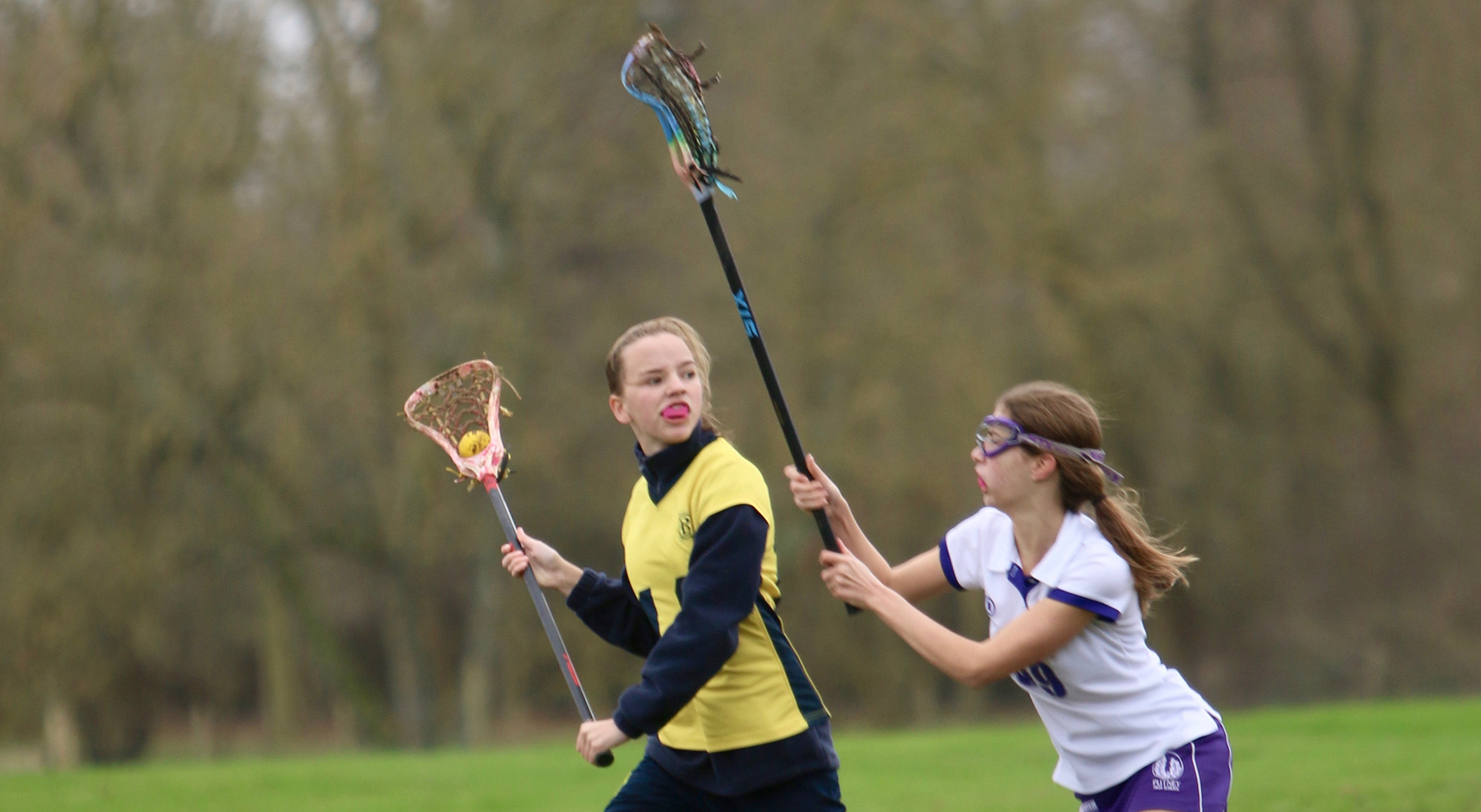 Girls playing Lacrosse