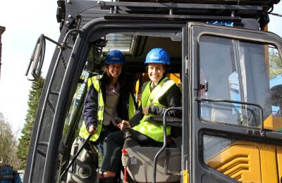 Girls and Head at controls of digger
