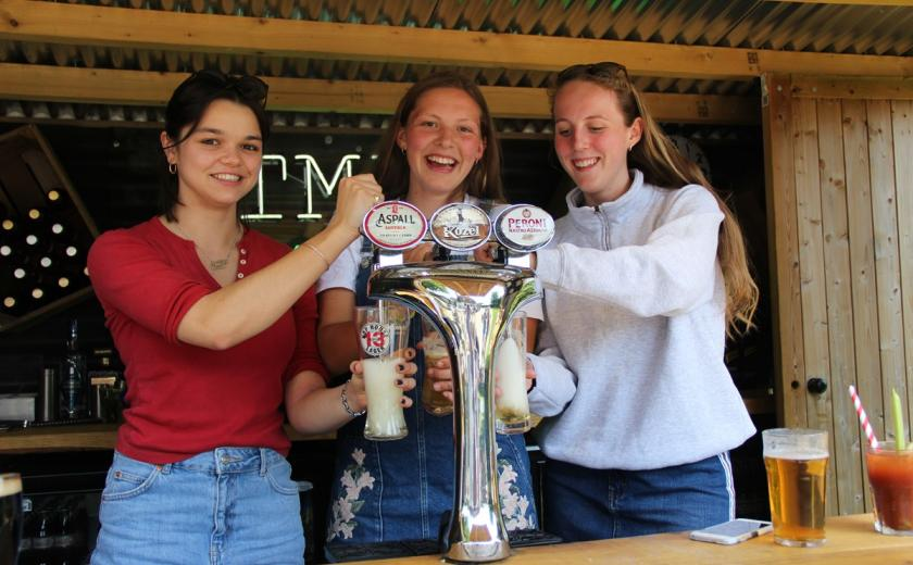Girls practice pulling pints